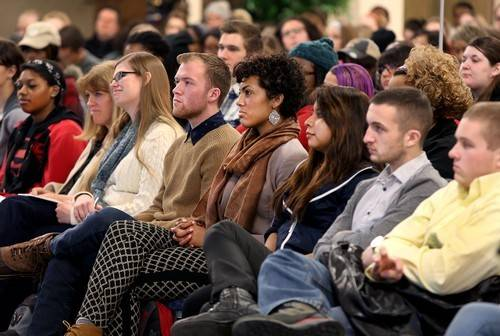 Crowd attentively listening to Patrica Hill Collin's presentation